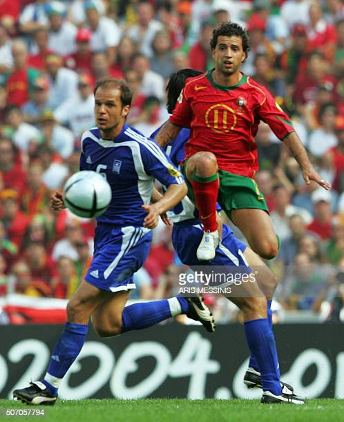 Greece's midfielder Angelis Basinas vies with Portugal's forward Simão Sabrosa 12 June 2004 at Dragao stadium in Porto during their Euro 2004 group A...