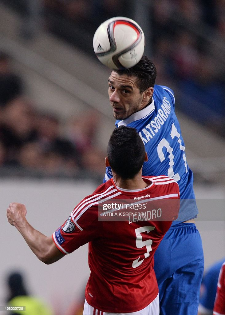 Greece's midfielder Kostas Katsouranis (R) vies with Hungary's defender Leandro during the Euro 2016 qualifying football match between Hungary and Greece at the Groupama Arena in Budapest on March 29, 2015. The match ends 0-0.