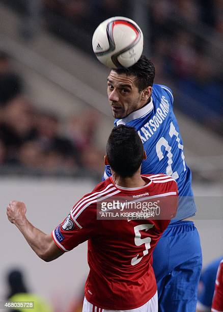 Greece's midfielder Kostas Katsouranis vies with Hungary's defender Leandro during the Euro 2016 qualifying football match between Hungary and Greece...