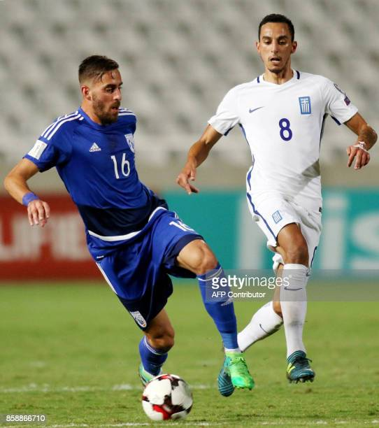 Greece's midfielder Zeca marks Cyprus' midfielder Charalampos Kyriakou during their World Cup 2018 qualifying Group H football match between Cyprus...