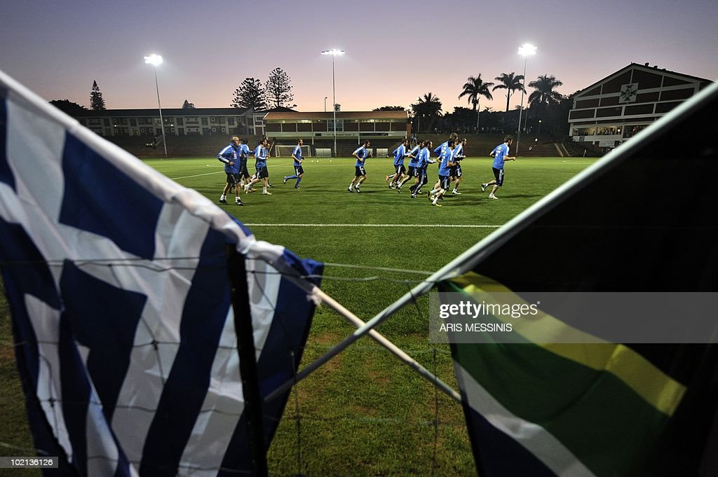Greece's national football team players run during a training session at the Northwood school in Durban on June 7, 2010 ahead of the 2010 World Cup football tournament.