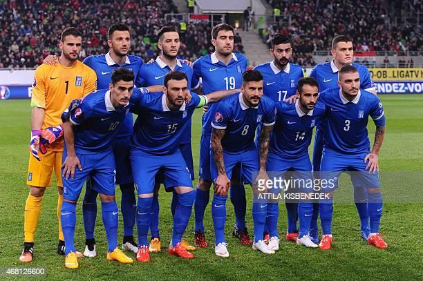Greece's national team players midfielder Lazaros Christodoulopoulos defender Vasilis Torosidis midfielder Panagiotis Kone midfielder Giannis...