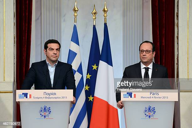 Greece's new Prime Minister Alexis Tsipras and French President Francois Hollande talk to the media following their meeting to discuss the Eurozone...