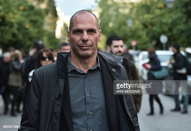 Greece's newly appointed finance minister Yanis Varoufakis walks along a street in Athens on January 27 2015 Greece named radical leftwing economist...