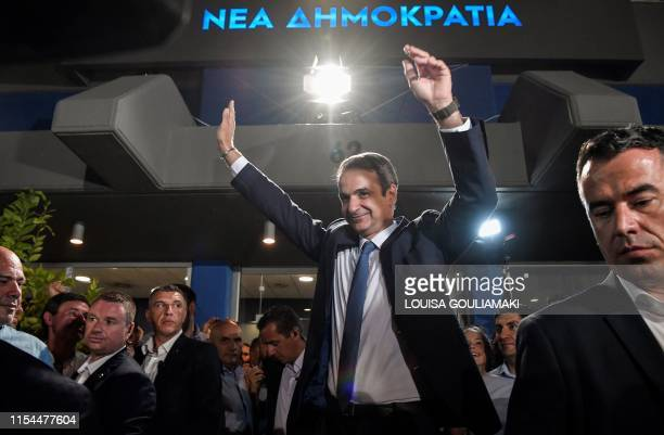 Greece's newly elected Prime Minister and leader of conservative New Democracy party Kyriakos Mitsotakis waves at his supporters outside the party's...