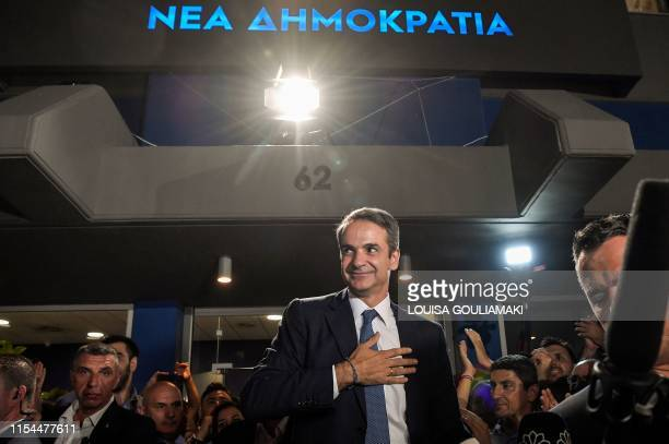 Greece's newly elected Prime Minister and leader of conservative New Democracy party Kyriakos Mitsotakis reacts as he greets his supporters outside...