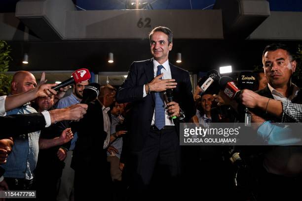 Greece's newly elected Prime Minister and leader of conservative New Democracy party Kyriakos Mitsotakis greets his supporters outside the party's...
