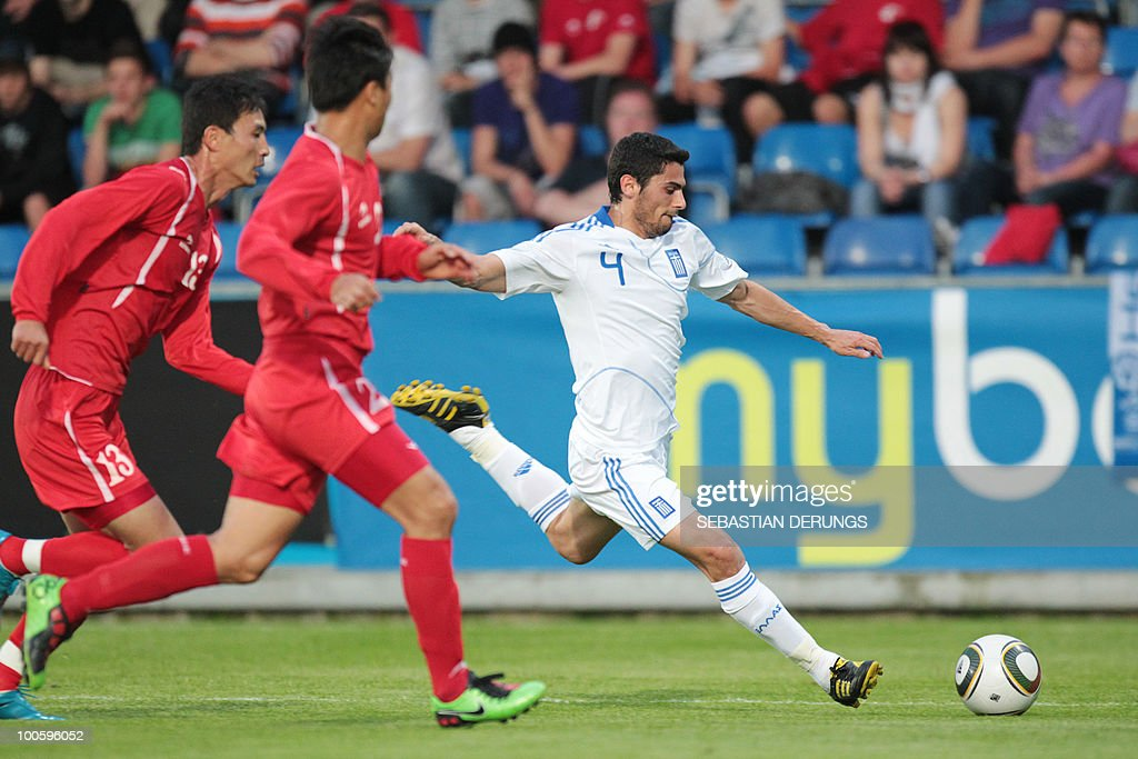 Greece's Nikolaos Spyropoulos (R) vies for the ball with North Korea's Chol Jin Pak (L) and Jong Hyok Cha (C) during a friendly football game, in Altach on May 25, 2010 ahead of their participation to the FIFA World Cup 2010 in South Africa.
