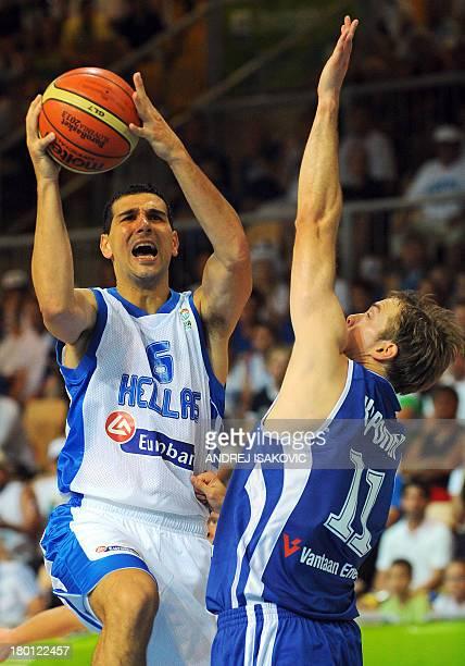 Greece's Nikos Zisis vies with Finland's Petteri Koponen during a FIBA Eurobasket championships qualifying basketball match Greece vs Finland in...