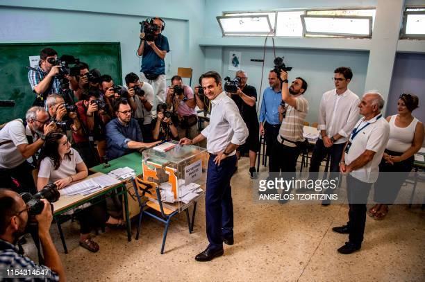 TOPSHOT Greece's opposition party New Democracy leader Kyriakos Mitsotakis casts his vote during general elections at a polling station in Athens on...