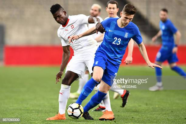 Greece's Panagiotis Retsos fights for the ball with Switzerland's Breel Embolo during the international friendly football match between Greece and...