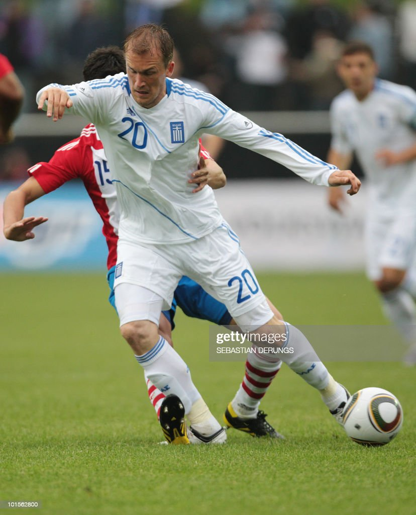 Greece's Pantelis Kapetanos (20) vies for the ball with Paraguay's Victor Caceres during a friendly football game in Winterthur on June 2, 2010 ahead of their participation to the FIFA World Cup 2010 in South Africa.