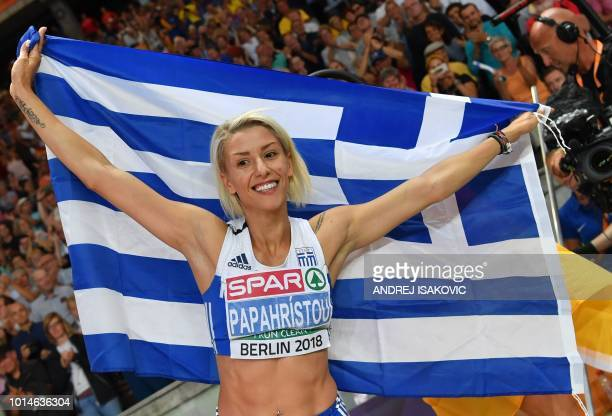 Greece's Paraskevi Papahristou celebrates with her national flag after winning the women's Triple Jump final during the European Athletics...