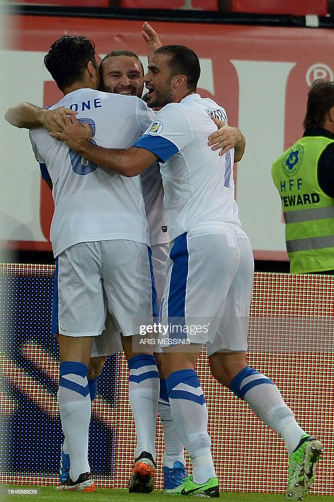 Greece's players celebrate after scoring during the 2014 World Cup qualifying football match Greece vs Liechtenstein at the Karaiskaki stadium in Athens on October 15, 2013. AFP PHOTO / Aris Messinis
