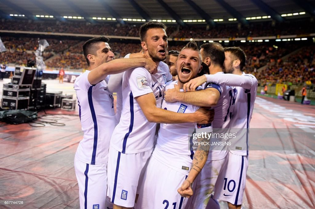 Greece's players celebrate after scoring during the World Cup 2018 qualifying football match Belgium vs Greece on March 25, 2017 at the King Baudouin stadium in Brussels. / AFP PHOTO / Belga / YORICK JANSENS / Belgium OUT