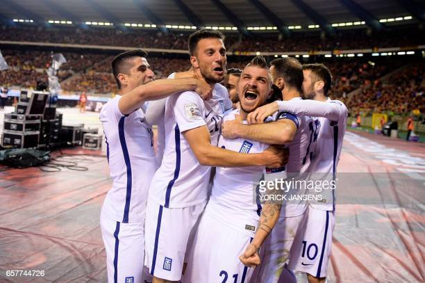 Greece's players celebrate after scoring during the World Cup 2018 qualifying football match Belgium vs Greece on March 25 2017 at the King Baudouin...