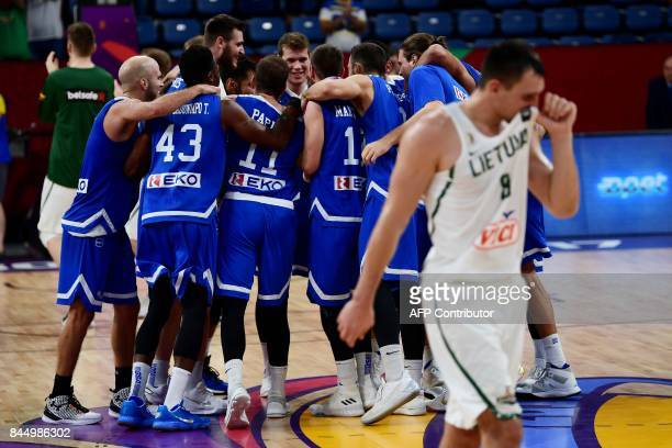 Greece's players celebrate after winning against Lithuania the FIBA Eurobasket 2017 men's round 16 basketball match at Sinan Erdem Sport Arena in...