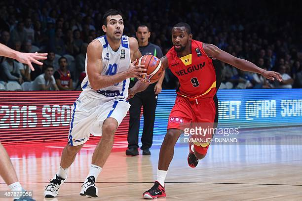 Greece's point guard Kostas Sloukas dribbles around Belgium's shooting guard Jonathan Tabu during the round of 16 basketball match between Greece and...