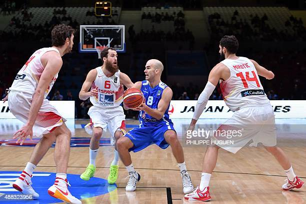Greece's point guard Nick Calathes is cornered by Spain's center Pau Gasol Spain's point guard Sergio Rodriguez and Spain's center Nikola Mirotic...