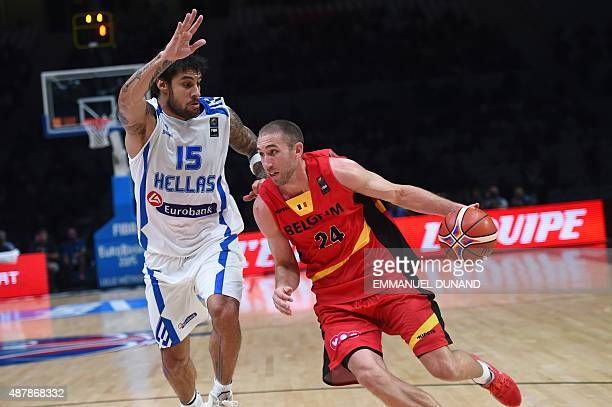 Greece's power forward Georgios Printezis defends against Belgium's shooting guard Matt Lojeski during the round of 16 basketball match between...