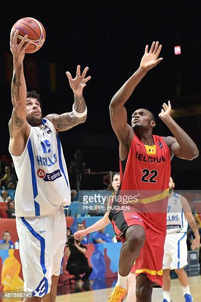 Greece's power forward Georgios Printezis goes to the basket past Belgium's center Kevin Tumba during the round of 16 basketball match between Greece...