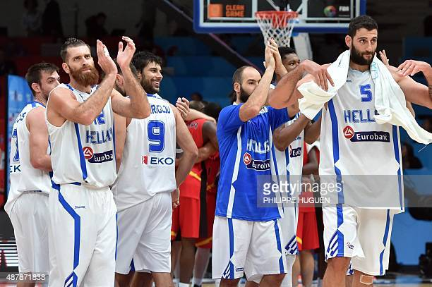 Greece's power forward Kostas Kaimakoglou Greece's center Yannis Bourousis and their teammates react after Greece defeated Belgium in their round of...