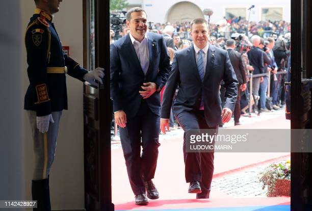 Greece's Prime Minister Alexis Tsipras and Estonia's Prime Minister Juri Ratas arrive for a working session during an EU summit in Sibiu central...