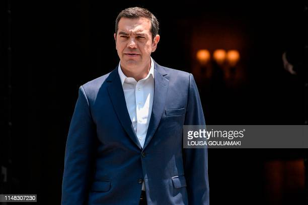Greece's prime minister Alexis Tsipras arrives to make a statement to the press outside his office in Athens on June 6 2019