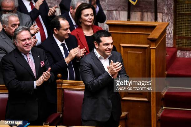 TOPSHOT Greece's Prime Minister Alexis Tsipras celebrates after a voting session on the Prespa Agreement an agreement aimed at ending a 27year...