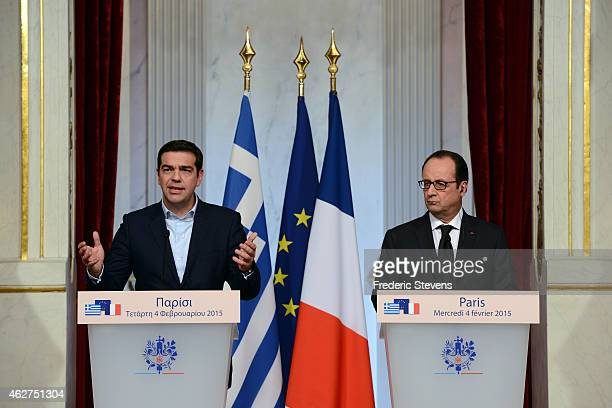 Greece's Prime Minister Alexis Tsipras delivers a speech with French President Francois Hollande at Elysee Palace after their meeting to discuss the...