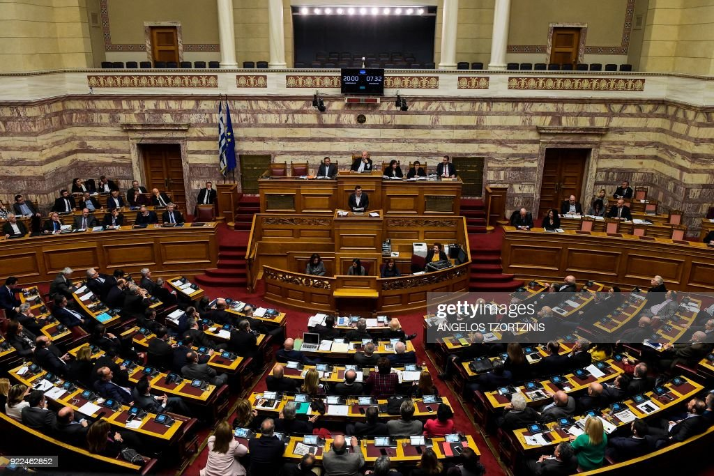 Greece's Prime Minister Alexis Tsipras speaks during a parliamentary debate in Athens in the early hours of February 22, 2018, prior to a vote on his demand to launch an investigation into whether nearly a dozen senior politicians received bribes from, or helped promote, Swiss pharmaceutical giant Novartis during their term in office. /