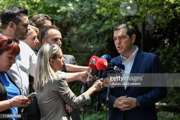 Greece's prime minister Alexis Tsipras speaks to the press outside his office in Athens on June 6 2019