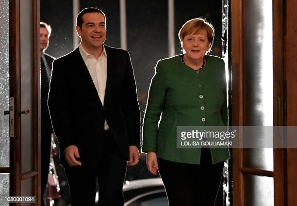 Greece's Prime Minister Alexis Tsipras walks with German Chancellor Angela Merkel after she arrived in Athens on January 10 2019 German Chancellor...