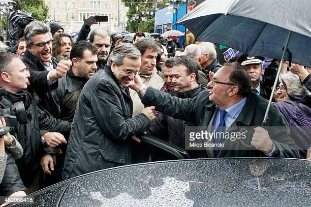 Greece's Prime Minister Antonis Samaras with his supporters outside an election kiosk of his conservative New Democracy party on January 24 2015 in...