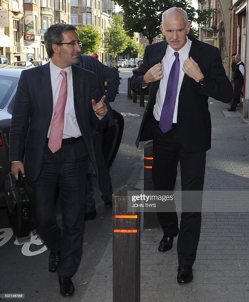 Greece's Prime Minister George Papandreou (R) arrives at the Party of European Socialists meeting (PES) on the eve of negotiations for the future of the country and a crucial European Council for the EU in Brussels on June 16, 2010.