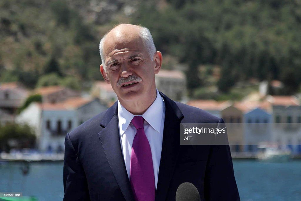 Greece's Prime Minister George Papandreou speaks to journalists during his visit on the island of Kastelorizo, southeastern Greece, on April 23, 2010. Greece appealed for a debt rescue from the EU and IMF on April 23 and said that help should arrive within days, in a dramatic turn for the eurozone at risk from Greek contagion. George Papandreou told his nation in a televised speech that the aid was a 'national need' which would 'offer us a safe port to allow our boat to float again.'AFP PHOTO / EUROKINISSI / Tatiana Bolari / GREECE OUT