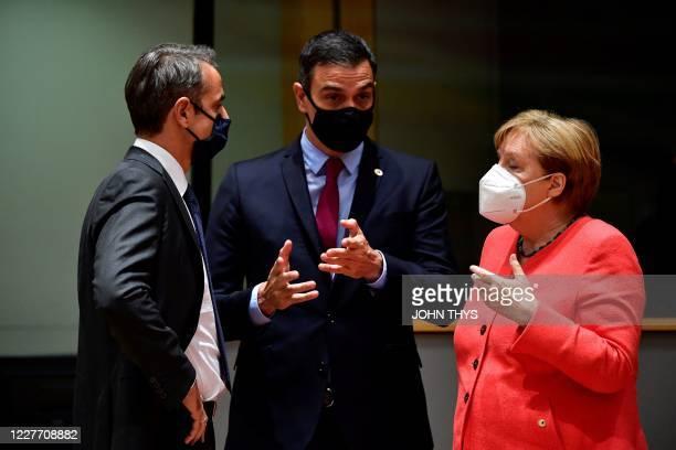 Greece's Prime Minister Kyriakos Mitsotakis Spain's Prime Minister Pedro Sanchez and Germany Chancellor Angela Merkel speak during an EU summit in...