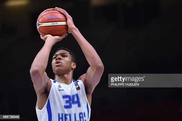 Greece's small forward Giannis Antetokounmpo shoots a penalty during the classification basketball match between Greece and Latvia at the EuroBasket...