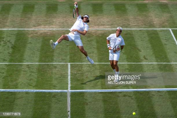 Greece's Stefanos Tsitsipas and Petros Tsitsipas play against Spain's Jaume Munar and Britain's Cameron Norrie in their first round mens's doubles...