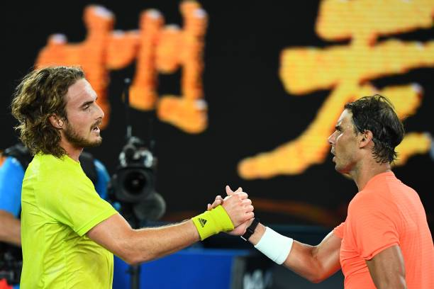 Greece's Stefanos Tsitsipas and Spain's Rafael Nadal greet each other after their men's singles quarter-final match on day ten of the Australian Open...