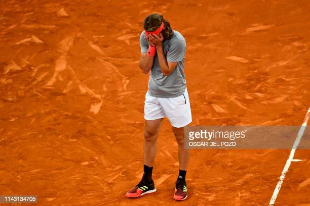 Greece's Stefanos Tsitsipas celebrates after defeating Spain's Rafael Nadal during their ATP Madrid Open semi-final tennis match at the Caja Magica...