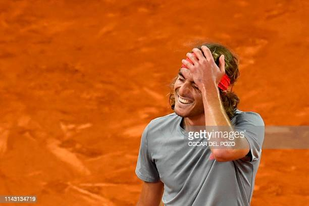 TOPSHOT Greece's Stefanos Tsitsipas celebrates after defeating Spain's Rafael Nadal during their ATP Madrid Open semifinal tennis match at the Caja...