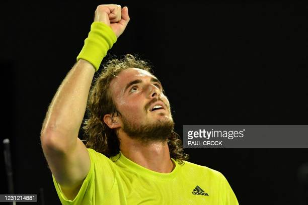 Greece's Stefanos Tsitsipas celebrates after victory against Spain's Rafael Nadal during their men's singles quarter-final match on day ten of the...
