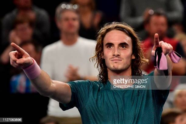 Greece's Stefanos Tsitsipas celebrates after winning against Kazakhstan's Mikhail Kukushkin in their men's singles final match at the ATP Open 13...