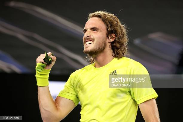 Greece's Stefanos Tsitsipas celebrates after winning against Spain's Rafael Nadal during their men's singles quarter-final match on day ten of the...