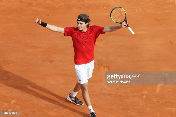 TOPSHOT Greece's Stefanos Tsitsipas celebrates after winning his tennis match against Canada's Denis Shapovalov at the MonteCarlo ATP Masters Series...