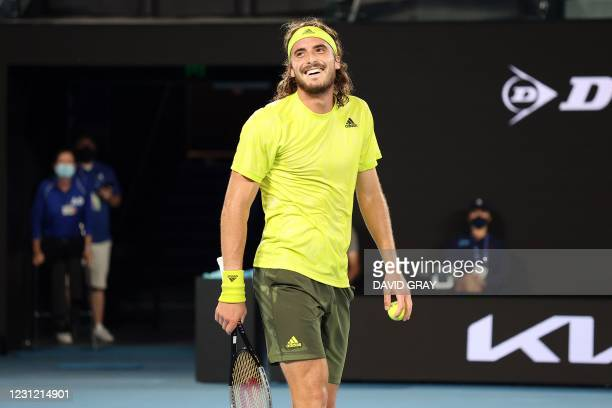 Greece's Stefanos Tsitsipas celebrates his match point against Spain's Rafael Nadal during their men's singles quarter-final match on day ten of the...