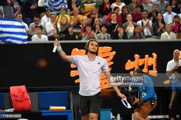Greece's Stefanos Tsitsipas celebrates his victory against Italy's Salvatore Caruso during their men's singles match on day one of the Australian...