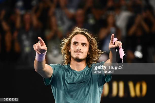 TOPSHOT Greece's Stefanos Tsitsipas celebrates his victory against Switzerland's Roger Federer during their men's singles match on day seven of the...