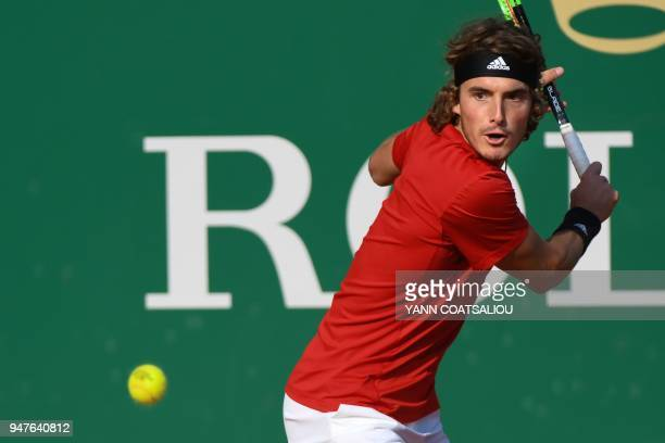 Greece's Stefanos Tsitsipas hits a return to Belgium's David Goffin during their round of 32 tennis match at the MonteCarlo ATP Masters Series...